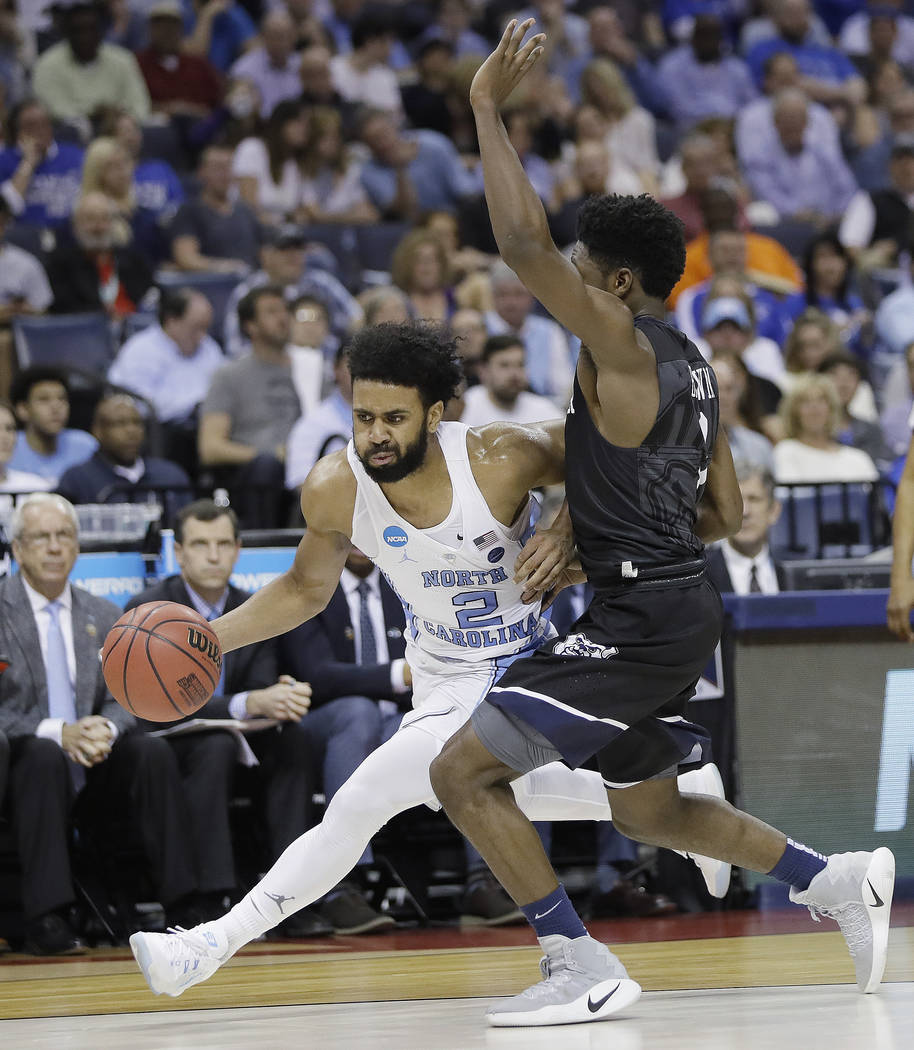 North Carolina guard Joel Berry II (2) drives against Butler guard Kamar Baldwin in the second half of an NCAA college basketball tournament South Regional semifinal game Friday, March 24, 2017, i ...