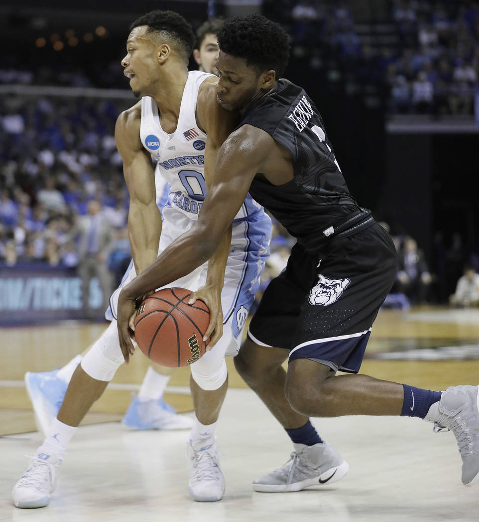 Butler guard Kamar Baldwin works for the ball against North Carolina guard Nate Britt in the second half of an NCAA college basketball tournament South Regional semifinal game Friday, March 24, 20 ...