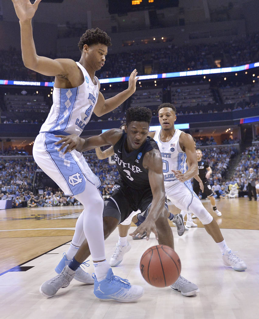 Butler guard Kamar Baldwin runs into the defense of North Carolina forward Justin Jackson in the second half of an NCAA college basketball tournament South Regional semifinal game Friday, March 24 ...