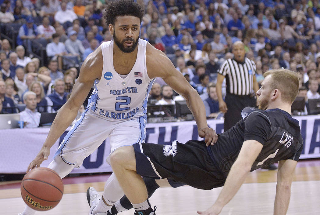 North Carolina guard Joel Berry II (2) moves past Butler guard Tyler Lewis in the first half of an NCAA college basketball tournament South Regional semifinal game Friday, March 24, 2017, in Memph ...