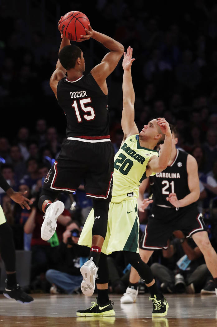 South Carolina guard PJ Dozier (15) puts up a shot against Baylor guard Manu Lecomte (20) in the second half of an East Regional semifinal game of the NCAA men's college basketball tournament, Fri ...