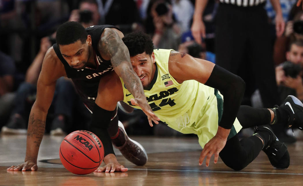 South Carolina guard Sindarius Thornwell (0) and Baylor guard Ishmail Wainright (24) scramble for a loose ball in the second half of an East Regional semifinal game of the NCAA men's college baske ...