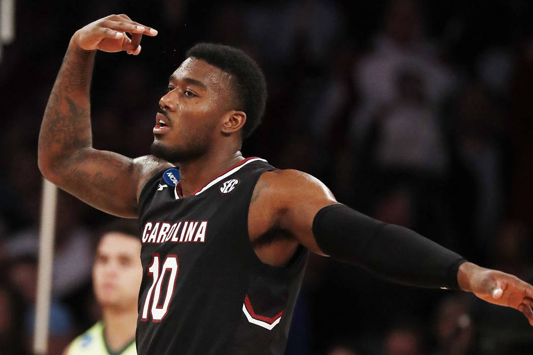 South Carolina guard Duane Notice (10) reacts after hitting a 3-point shot against Baylor in the second half of an East Regional semifinal game of the NCAA men's college basketball tournament, Fri ...