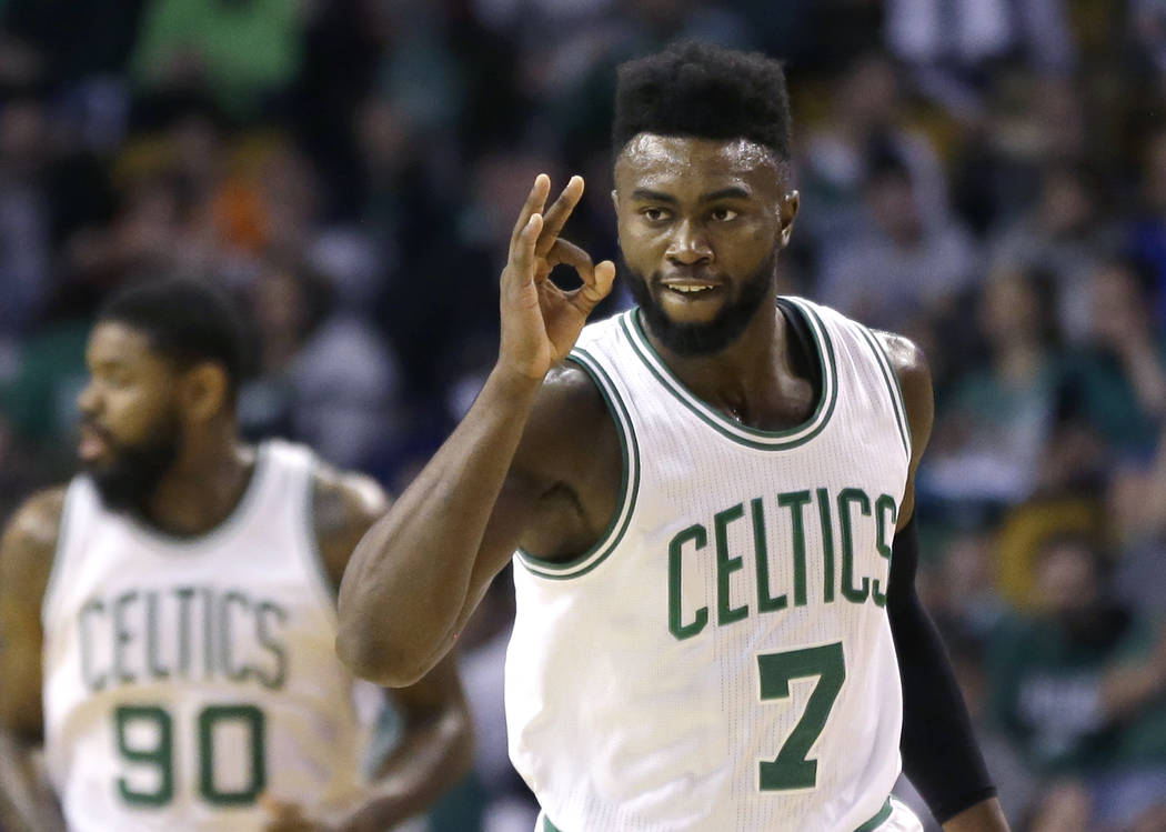 Boston Celtics forward Jaylen Brown (7) gestures after making a 3-point shot against the Phoenix Suns during the first quarter of an NBA basketball game, Friday, March 24, 2017, in Boston. (AP Pho ...