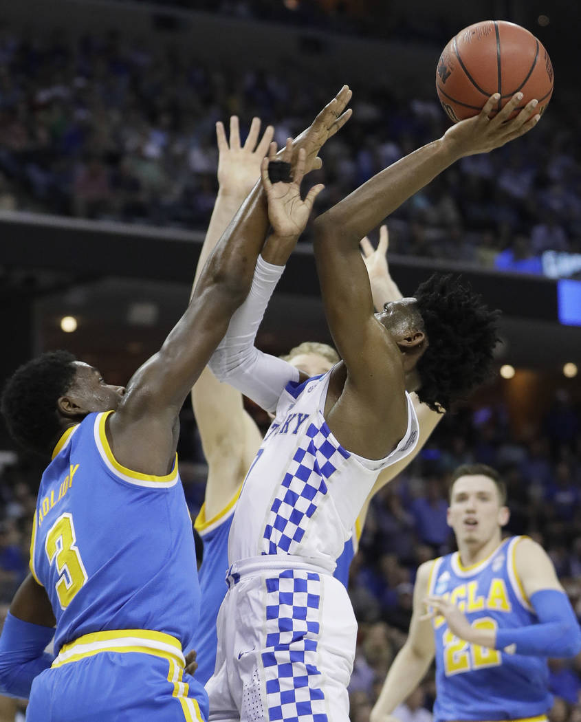 Kentucky guard De'Aaron Fox shoots against UCLA guard Aaron Holiday in the first half of an NCAA college basketball tournament South Regional semifinal game Friday, March 24, 2017, in Memphis, Ten ...