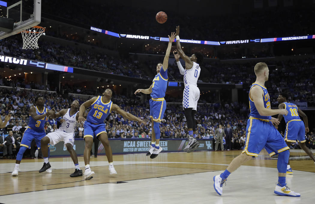 Kentucky guard De'Aaron Fox shoots against UCLA in the first half of an NCAA college basketball tournament South Regional semifinal game Friday, March 24, 2017, in Memphis, Tenn. (AP Photo/Mark Hu ...