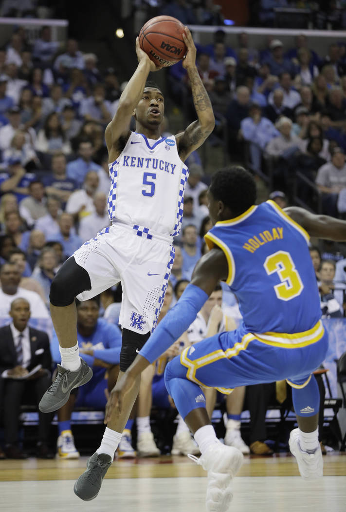 Kentucky guard Malik Monk shoots against UCLA guard Aaron Holiday in the first half of an NCAA college basketball tournament South Regional semifinal game Friday, March 24, 2017, in Memphis, Tenn. ...