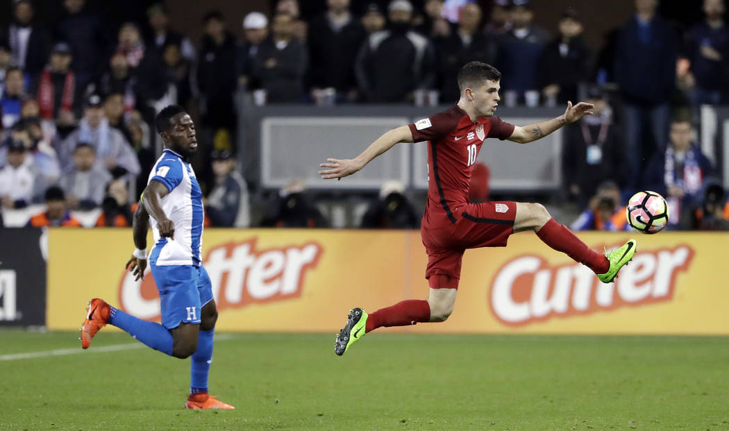 United States' Christian Pulisic, right, stops a pass next to a Honduras defender during the first half of a World Cup qualifying soccer match Friday, March 24, 2017, in San Jose, Calif. (AP Photo ...