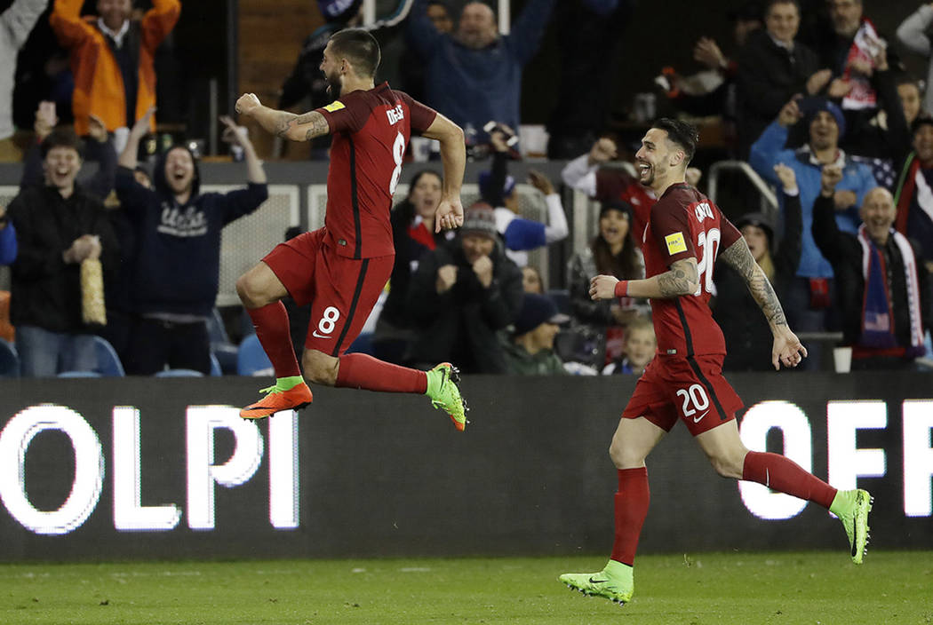United States' Clint Dempsey, center, celebrates his free-kick goal with teammate Geoff Cameron, right, during the second half of a World Cup qualifying soccer match against Honduras on Friday, Ma ...