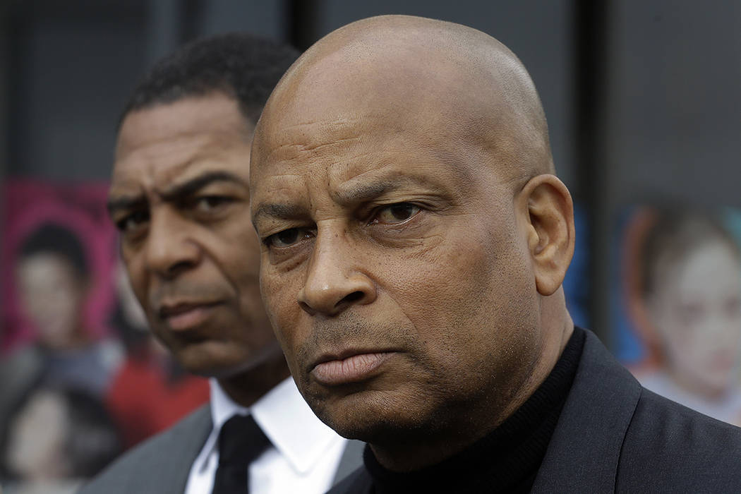 Former professional football players Ronnie Lott, right, and Marcus Allen speak at a media conference Tuesday, Dec. 13, 2016, in Oakland, Calif.  (AP Photo/Ben Margot)
