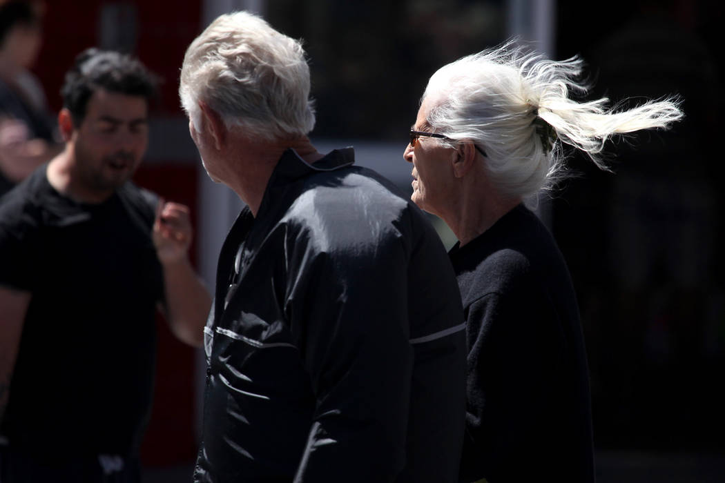 Betina Kelly, right, and Paul Kelly, left, walk down Fremont Street in downtown Las Vegas on Sunday, May 11, 2014. (Justin Yurkanin/Las Vegas Review-Journal)