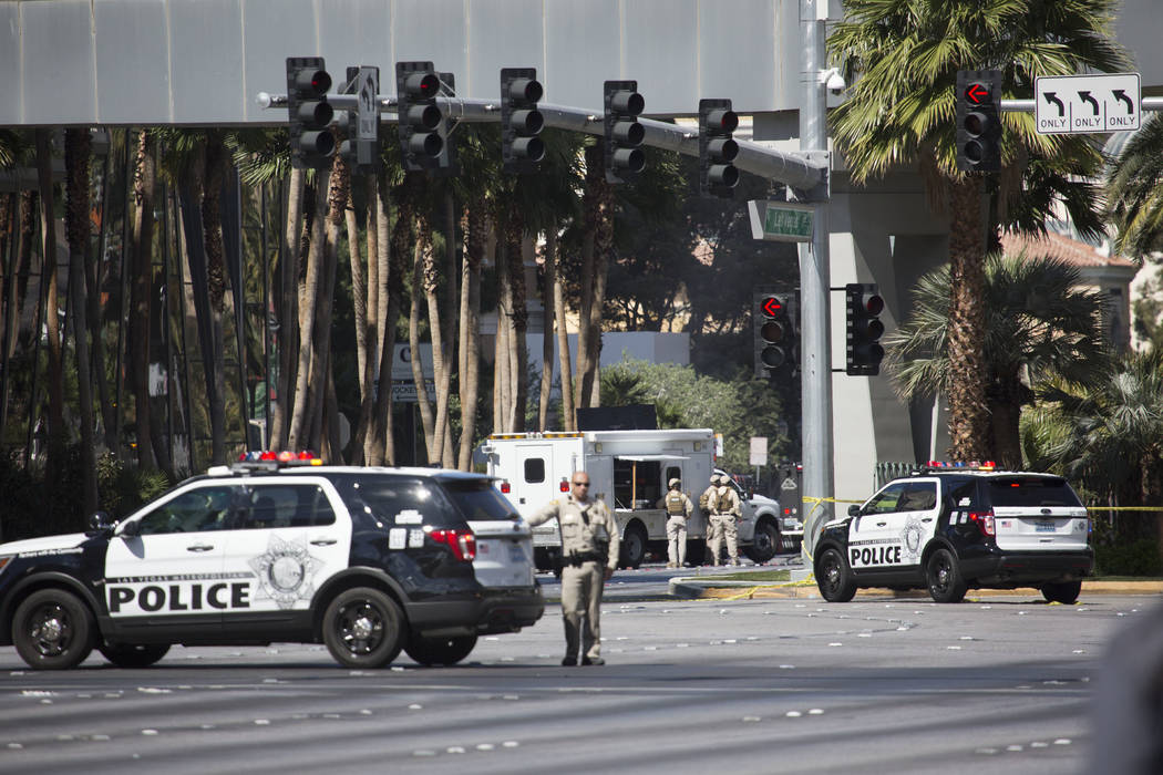 Officers occupy the intersection of Las Vegas Blvd. and Harmon Ave., just south the barricade, on Saturday, March 25, 2017, in Las Vegas. (Bridget Bennett/Las Vegas Review-Journal) @bridgetkbennett