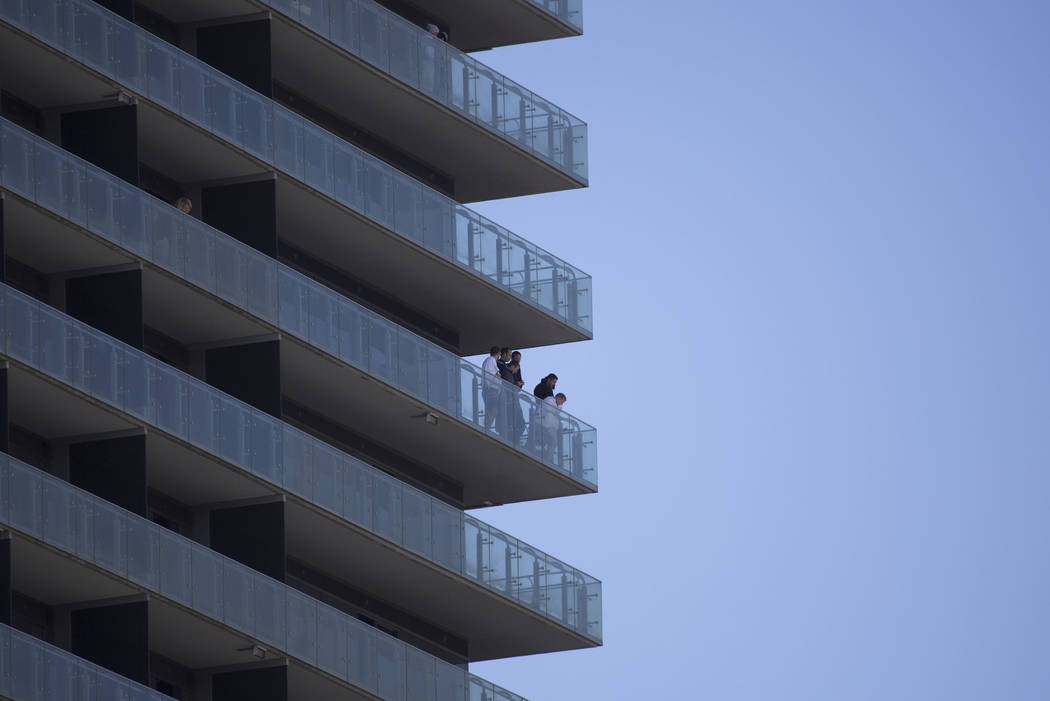 Visitors Look Off Their Balcony Of The Cosmopolitan Hotel To Las Vegas Blvd