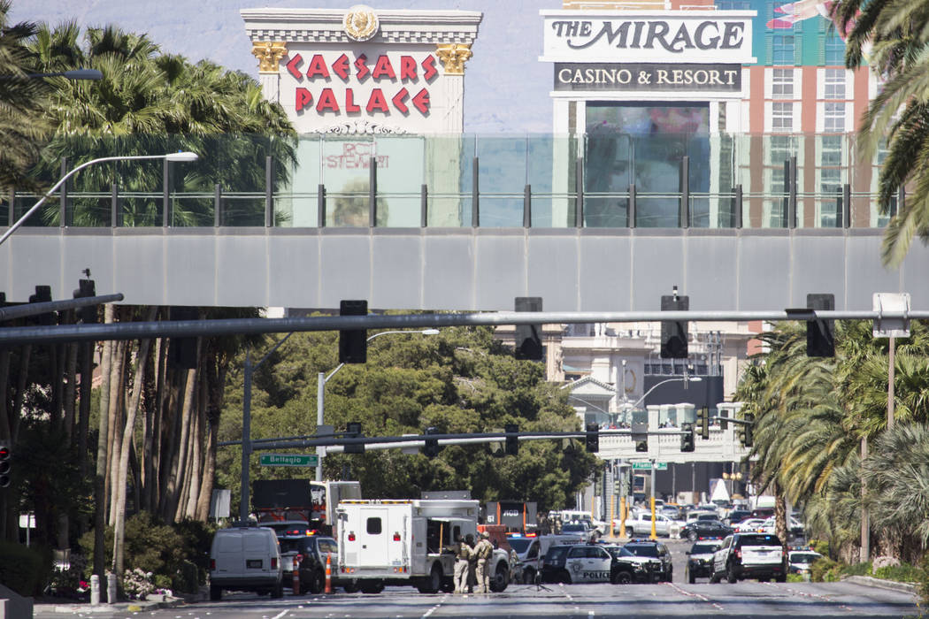 Officers barricade a bus, where the alleged suspect was located, in front of The Cosmopolitan Hotel-Casino near the intersection of  f Las Vegas Blvd. and Harmon Ave. Saturday, March 25, 2017, in  ...