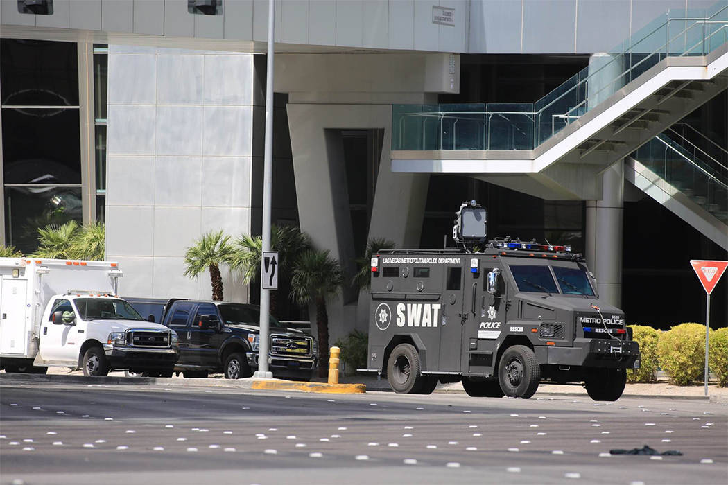 A SWAT truck pulls up outside The Cosmopolitan on Saturday afternooon