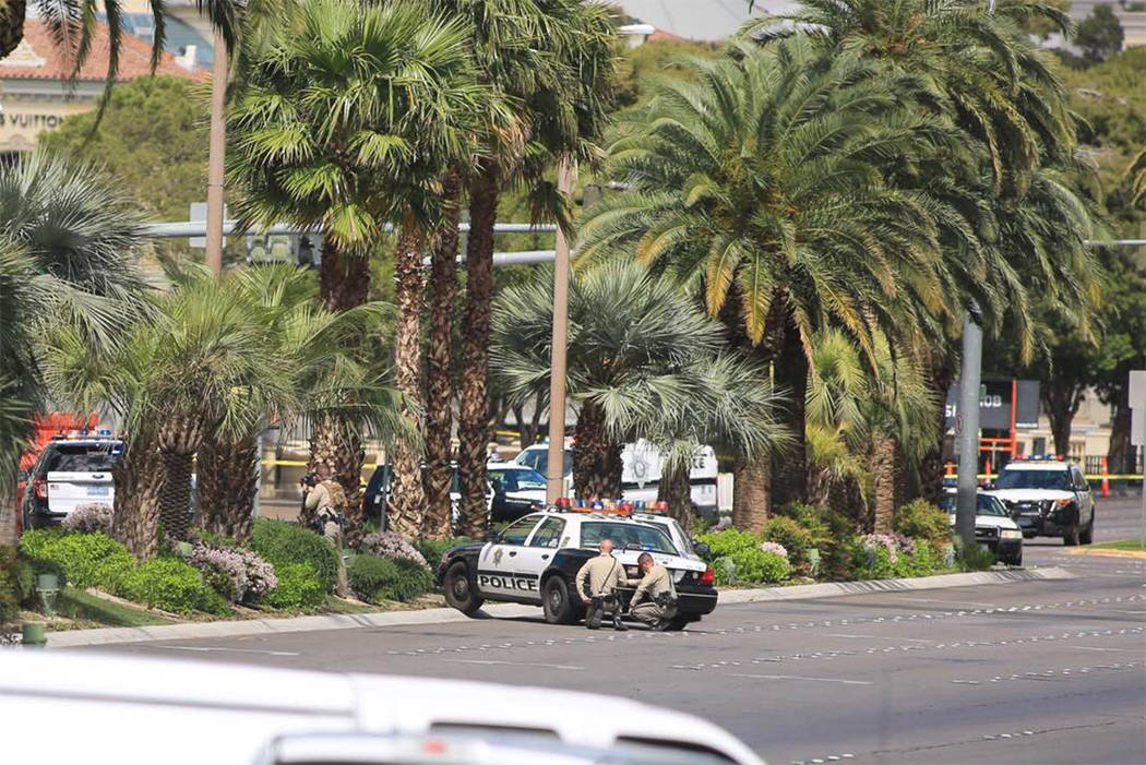 Las Vegas police take up positions outside The Cosmopolitan on the Strip on Saturday, March 25, 2017. (Brett Le Blanc/ Las Vegas Review-Journal) @bleblancphoto