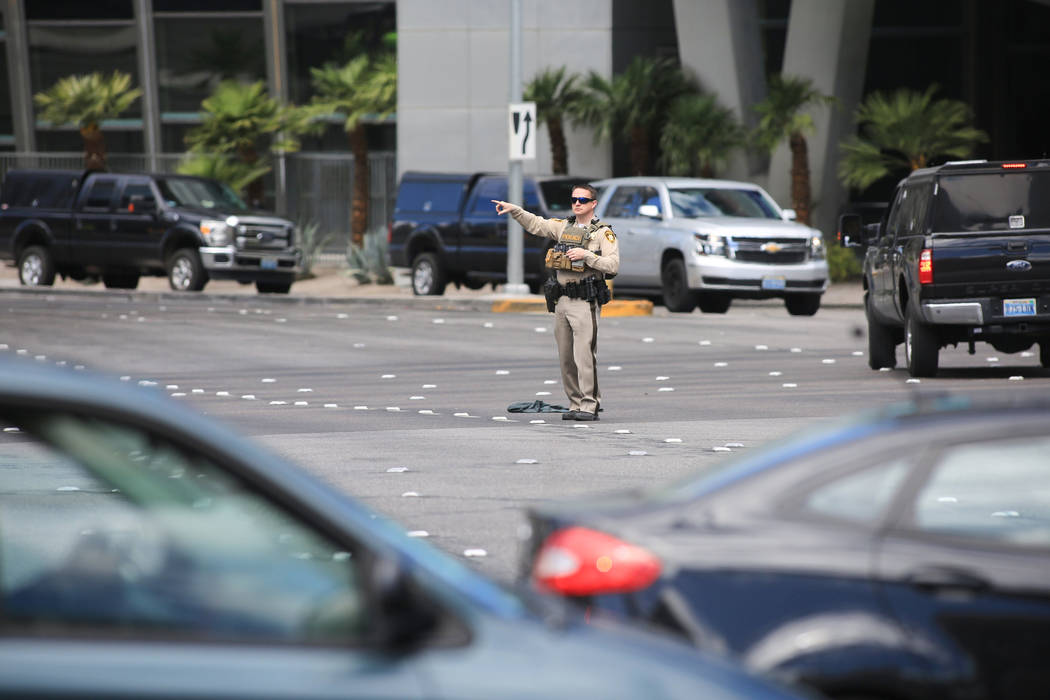 A police officer directs traffic at the intersection of Harmon Avenue and Las Vegas Boulevard outside of the Cosmopolitan hotel-casino in Las Vegas on Saturday, March 25, 2017. (Brett Le Blanc/Las ...