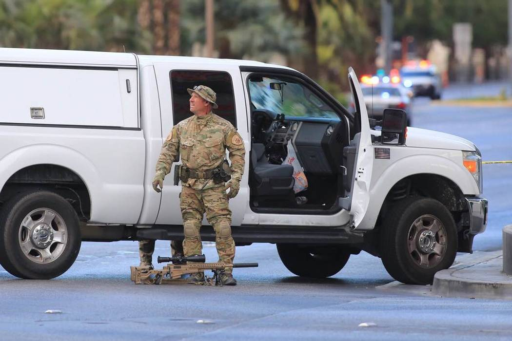 A police sniper breaks down his kit after the suspect in the bus barricade surrendered outside the Cosmopolitan on Saturday, March 25, 2017. (Brett Le Blanc/ Las Vegas Review-Journal) @bleblancphoto
