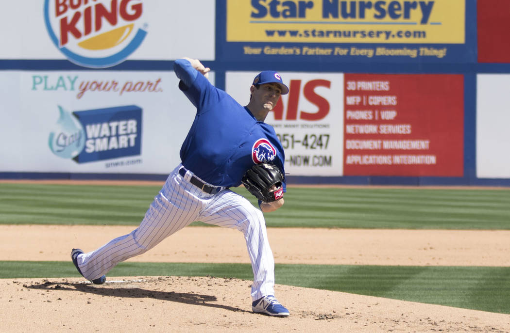 Chicago Cubs starting pitcher Kyle Hendricks throws a pitch at the top of the first inning during their game against the Cincinnati Reds at Cashman Field in Las Vegas on Saturday, March 25, 2017.  ...