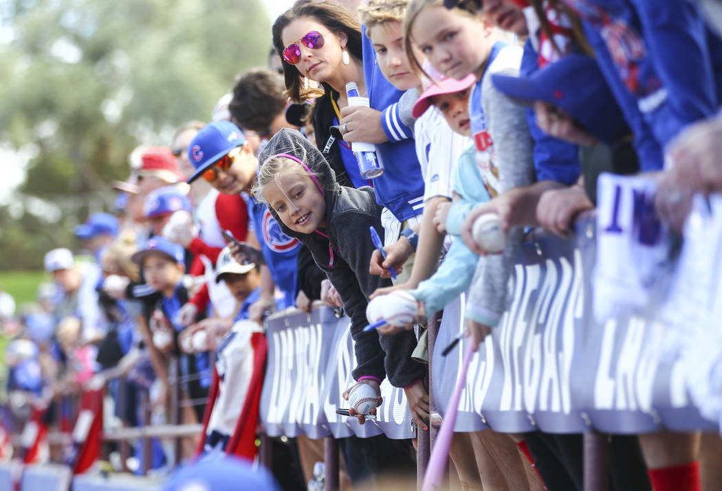 Fans hope to get autographs and greet players before the Big League Weekend baseball game between the Chicago Cubs and the Cincinnati Reds at Cashman Field in Las Vegas on Saturday, March 25, 2017 ...