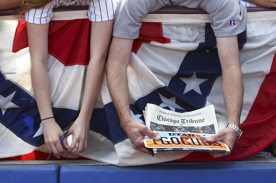 Fans hope to get autographs before the Big League Weekend baseball game between the Chicago Cubs and the Cincinnati Reds at Cashman Field in Las Vegas on Saturday, March 25, 2017. (Chase Stevens/L ...