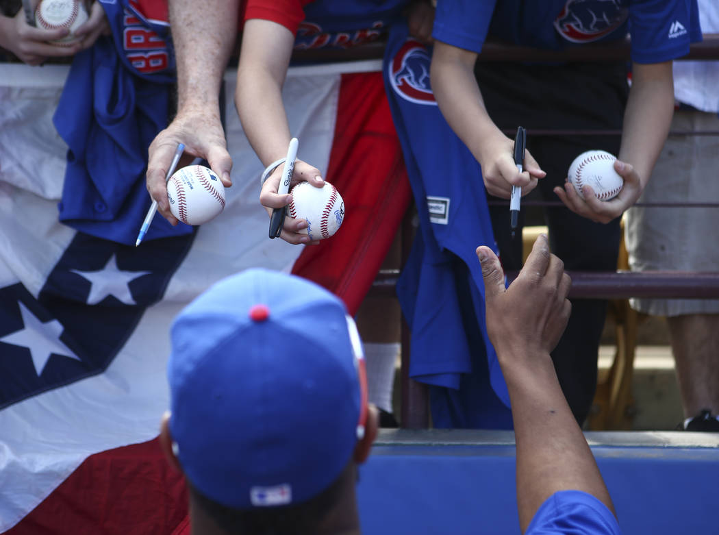 Chicago Cubs pitcher Daniel Corcino (55) signs items for fans before the Big League Weekend baseball game against the Cincinnati Reds at Cashman Field in Las Vegas on Saturday, March 25, 2017. (Ch ...