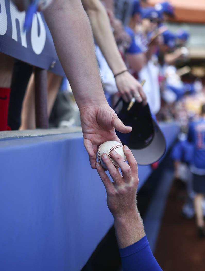 A fan gets a signed ball before the Big League Weekend baseball game at Cashman Field in Las Vegas on Saturday, March 25, 2017. (Chase Stevens/Las Vegas Review-Journal) @csstevensphoto