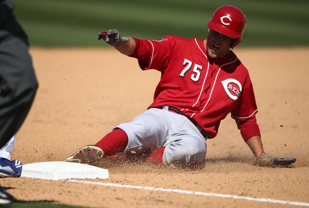 Cincinnati Reds' Patrick Kivlehan (75) slides into third base against the Chicago Cubs during their Big League Weekend baseball game at Cashman Field in Las Vegas on Saturday, March 25, 2017. (Cha ...