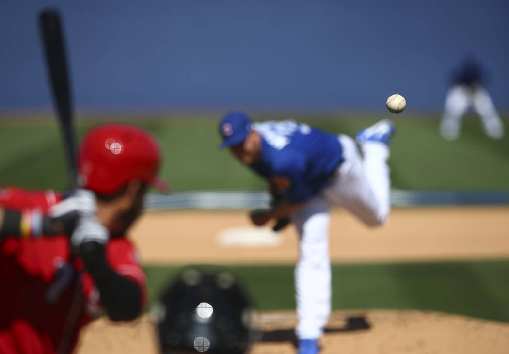 Chicago Cubs' Mike Montgomery (38) pitches to Cincinnati Reds' Eugenio Suarez (7) during their Big League Weekend baseball game at Cashman Field in Las Vegas on Saturday, March 25, 2017. (Chase St ...