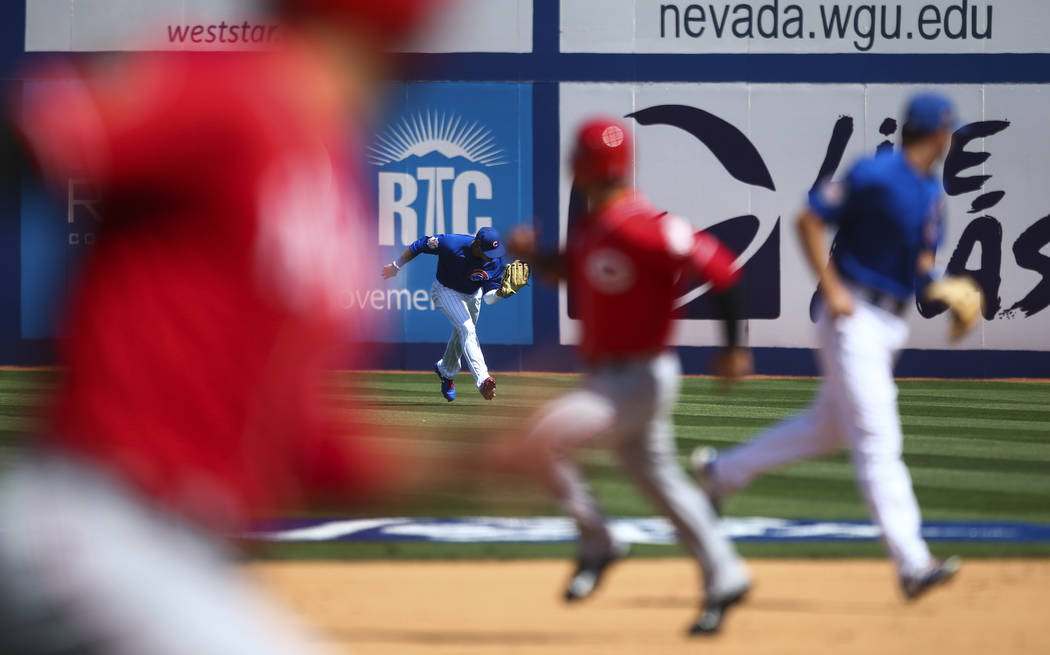 Chicago Cubs' Albert Almora Jr. (5) catches a fly ball from the Cincinnati Reds during their Big League Weekend baseball game at Cashman Field in Las Vegas on Saturday, March 25, 2017. (Chase Stev ...