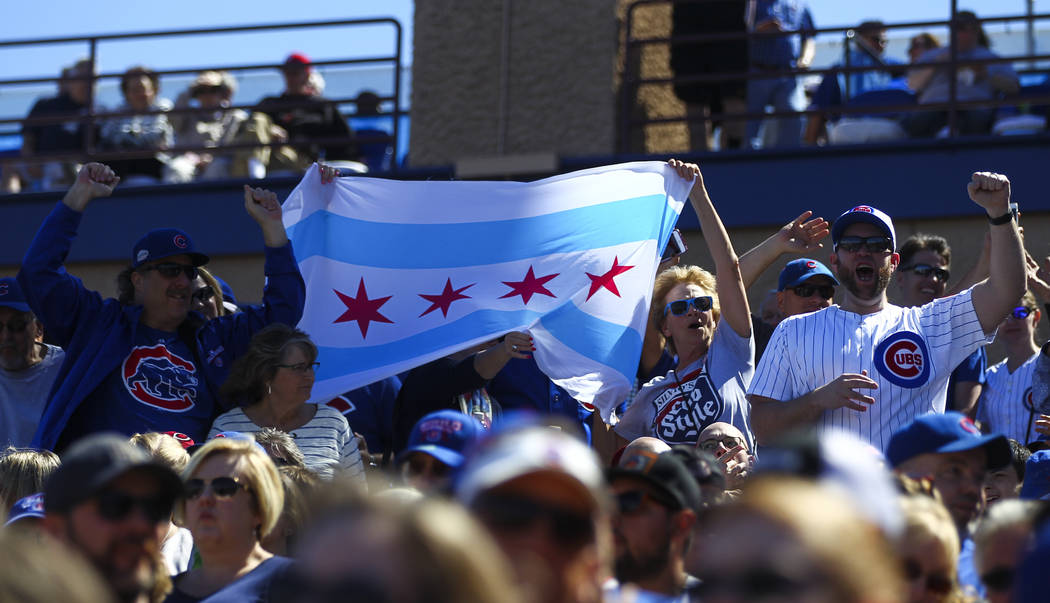 Chicago Cubs fans cheer as their team plays the Cincinnati Reds during a Big League Weekend baseball game at Cashman Field in Las Vegas on Saturday, March 25, 2017. (Chase Stevens/Las Vegas Review ...