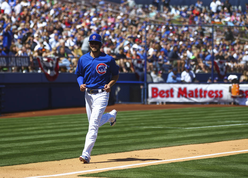 Chicago Cubs' Kris Bryant (17) scores a run against the Cincinnati Reds during their Big League Weekend baseball game at Cashman Field in Las Vegas on Saturday, March 25, 2017. (Chase Stevens/Las  ...