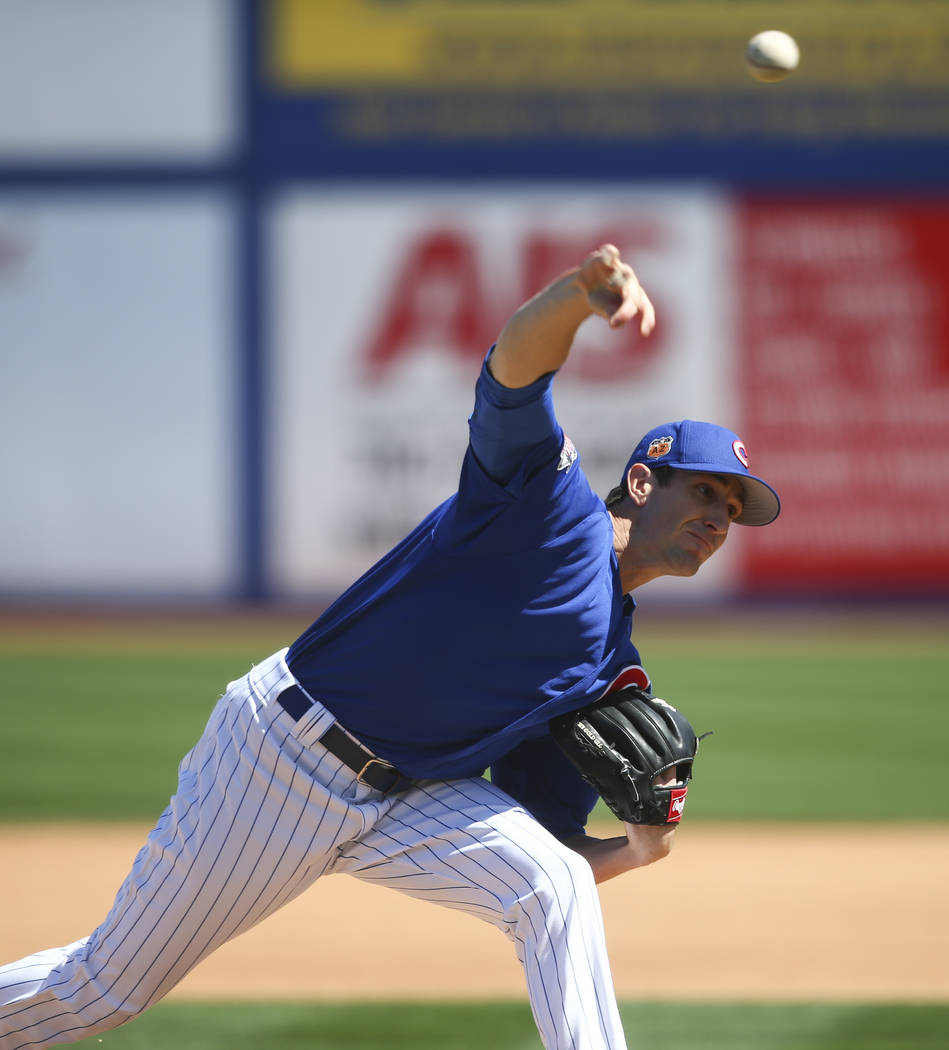 Chicago Cubs' Kyle Hendricks (28) pitches to the Cincinnati Reds during their Big League Weekend baseball game at Cashman Field in Las Vegas on Saturday, March 25, 2017. (Chase Stevens/Las Vegas R ...
