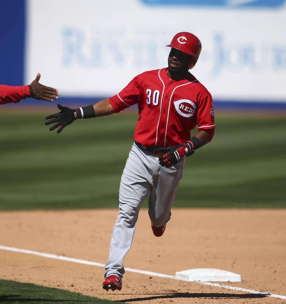 Cincinnati Reds' Arismendy Alcantara (30) rounds third base after hitting a home run against the Chicago Cubs during their Big League Weekend baseball game at Cashman Field in Las Vegas on Saturda ...