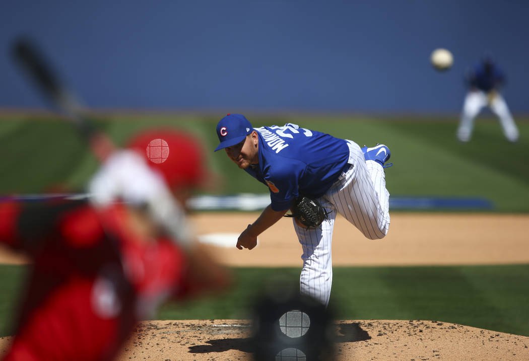 Chicago Cubs' Mike Montgomery (38) pitches to Cincinnati Reds' Billy Hamilton (6) during their Big League Weekend baseball game at Cashman Field in Las Vegas on Saturday, March 25, 2017. (Chase St ...