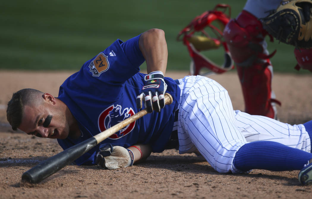 Chicago Cubs' John Andreoli (72) falls to the ground after getting hit by a pitch from the Cincinnati Reds during their Big League Weekend baseball game at Cashman Field in Las Vegas on Saturday,  ...