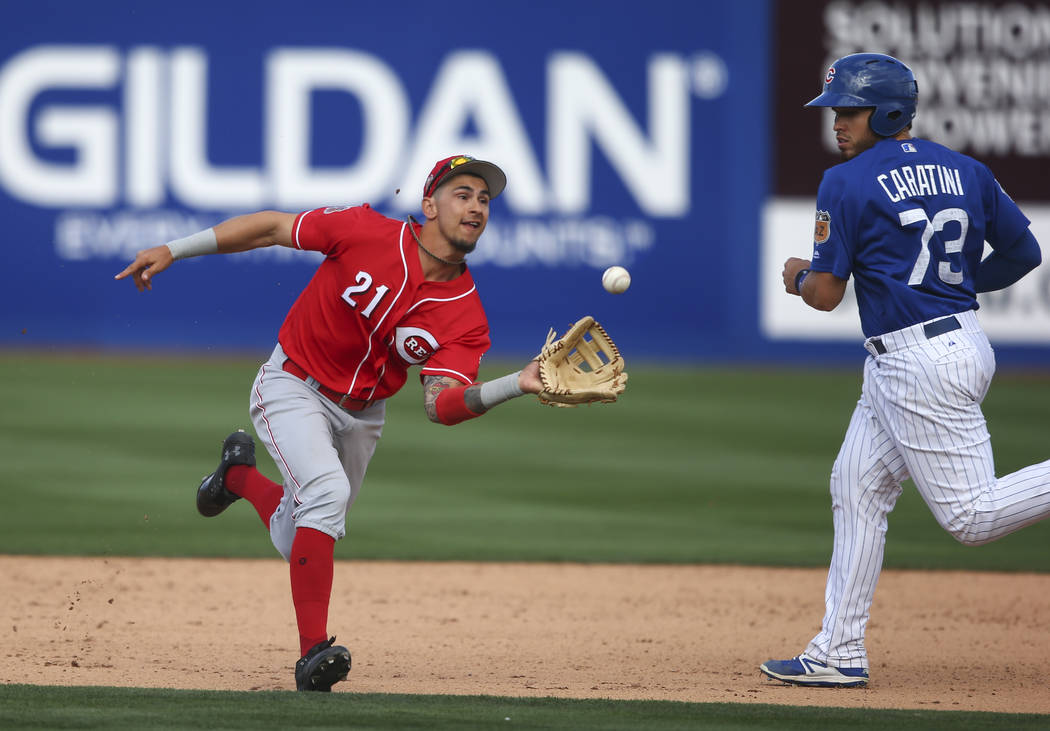 Cincinnati Reds' Michael Lorenzen (21) catches a fly ball from Chicago Cubs' Williams Perez (54) during their Big League Weekend baseball game at Cashman Field in Las Vegas on Saturday, March 25,  ...