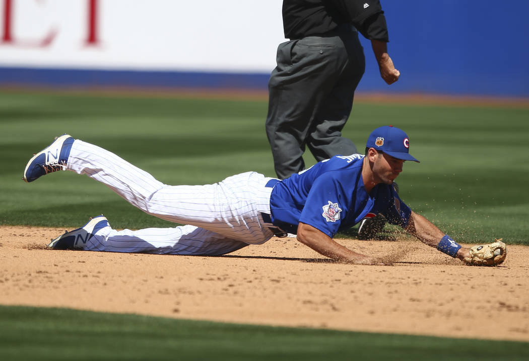 Chicago Cubs' Chesny Young (85) fields a grounder from the Cincinnati Reds during their Big League Weekend baseball game at Cashman Field in Las Vegas on Saturday, March 25, 2017. (Chase Stevens/L ...