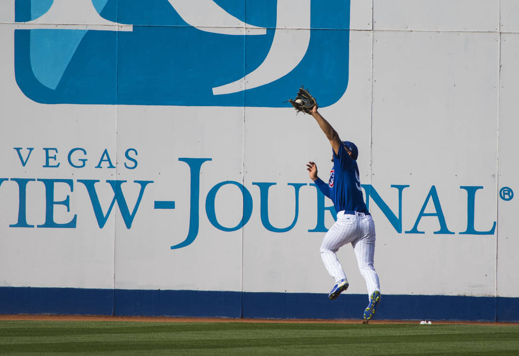 Chicago Cubs Charcer Burks (91) makes the game ending catch during their Big League Weekend baseball game against the Cincinnati Reds at Cashman Field in Las Vegas on Saturday, March 25, 2017. (Mi ...