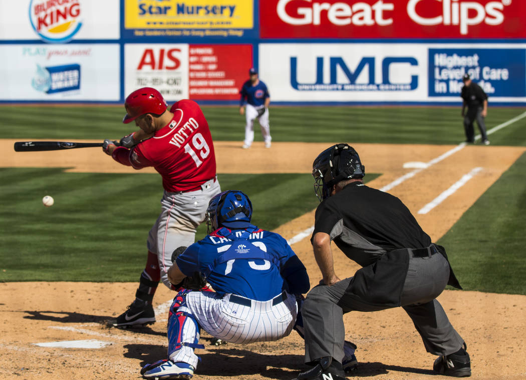 Cincinnati Reds Joey Votto (19) hits the ball during their Big League Weekend baseball game against the Chicago Cubs at Cashman Field in Las Vegas on Saturday, March 25, 2017. (Miranda Alam/Las Ve ...