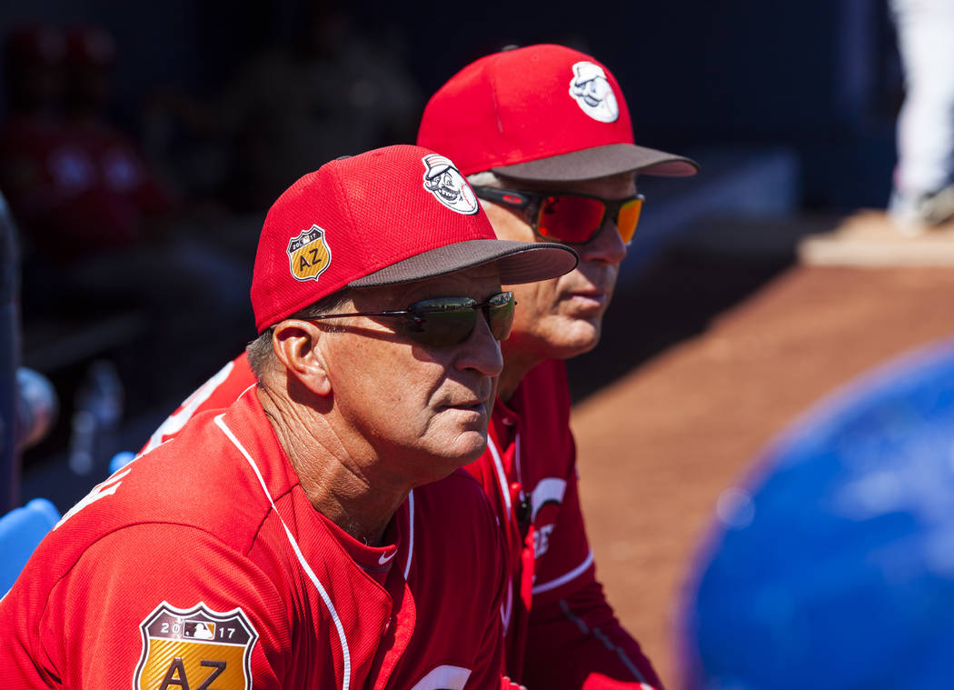 First base coach Kelly Pat (33), right, and manager Jim Riggleman (35), second from right, during their Big League Weekend baseball game against the Chicago Cubs at Cashman Field in Las Vegas on S ...