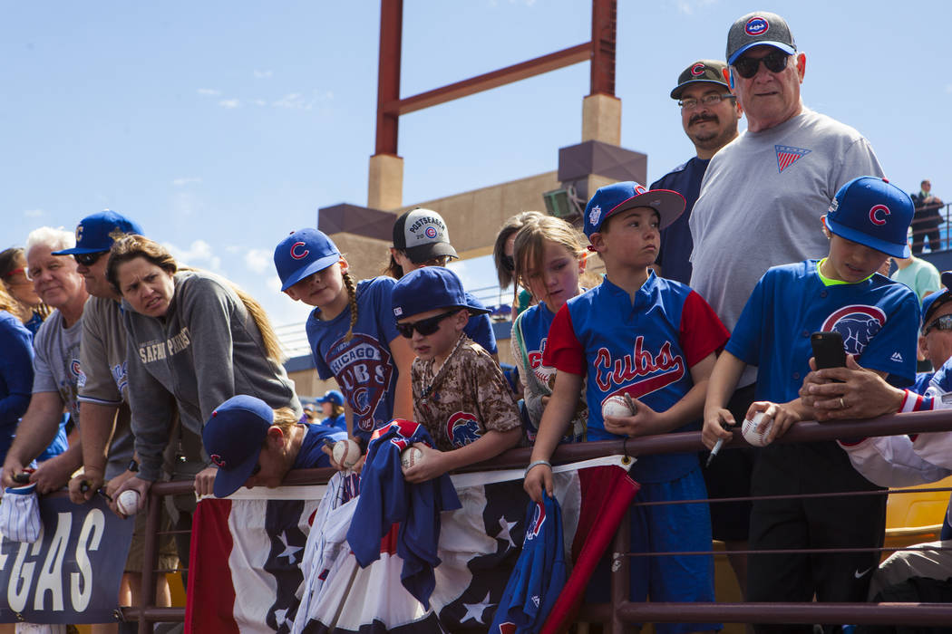 Fans wait for Chicago Cubs players to emerge form the dugout before the Big League Weekend baseball game against the Cincinnati Reds at Cashman Field in Las Vegas on Saturday, March 25, 2017. (Mir ...
