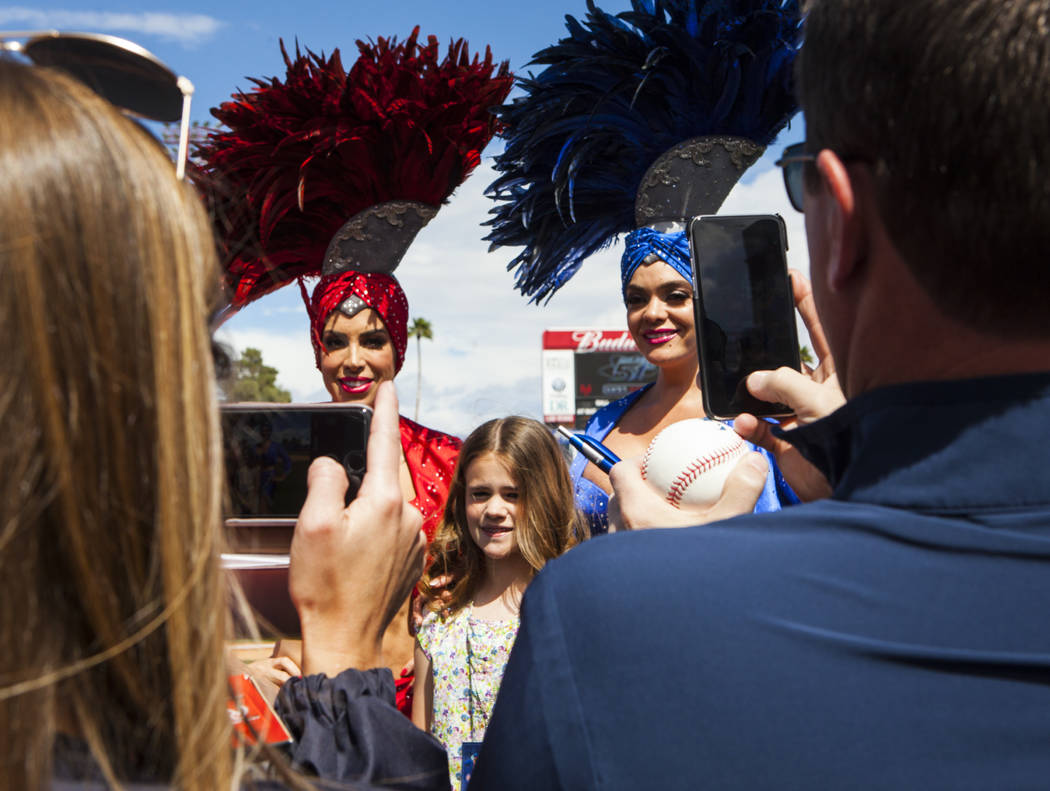 Las Vegas showgirls pose with fans before the Cincinnati Reds play the Chicago Cubs at the Big League Weekend baseball game at Cashman Field in Las Vegas on Saturday, March 25, 2017. (Miranda Alam ...