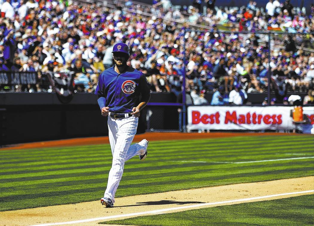 Chicago Cubs' Kris Bryant (17) scores a home run against the Cincinnati Reds during their Big League Weekend baseball game at Cashman Field in Las Vegas on Saturday, March 25, 2017. (Chase Stevens ...