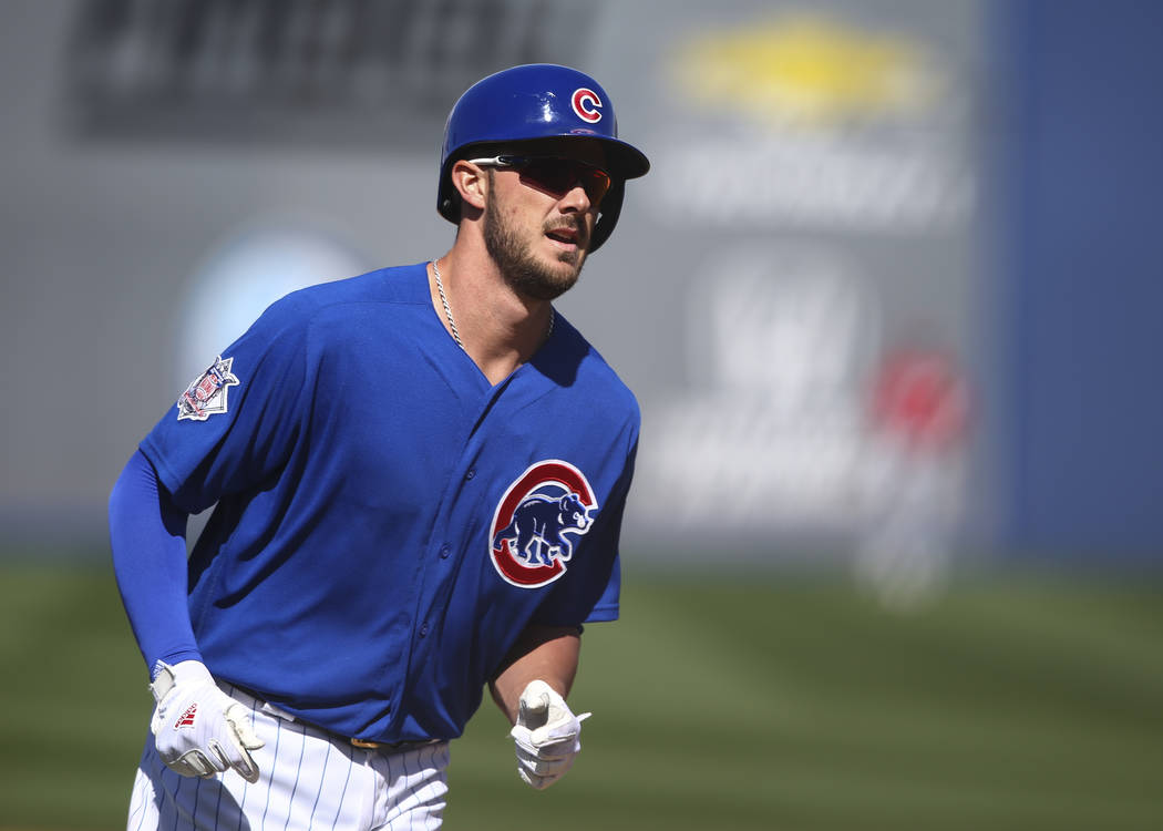 Chicago Cubs' Kris Bryant (17) rounds the bases after hitting a home run against Cincinnati during their Big League Weekend baseball game at Cashman Field in Las Vegas on Saturday, March 25, 2017. ...