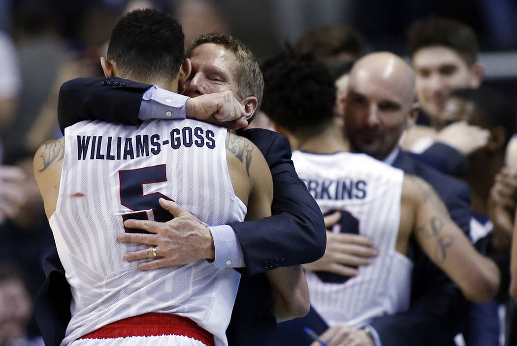 Gonzaga head coach Mark Few hugs guard Nigel Williams-Goss (5) in the closing minutes of a win over Xavier during an NCAA Tournament college basketball regional final game Saturday, March 25, 2017 ...