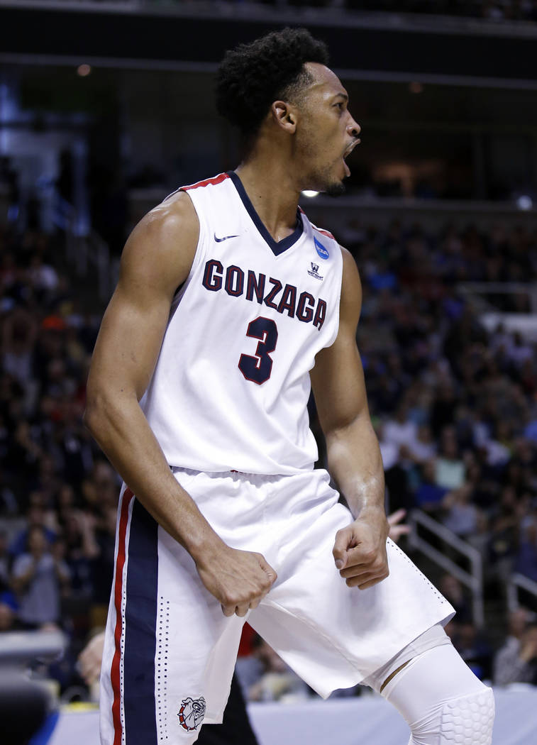 Gonzaga forward Johnathan Williams (3) celebrates after scoring against Xavier during the first half of an NCAA Tournament college basketball regional final game Saturday, March 25, 2017, in San J ...