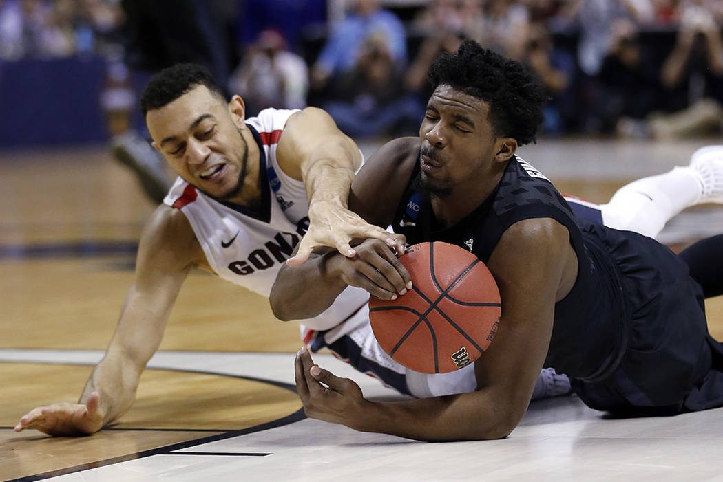 Xavier guard Quentin Goodin, right, grabs a loose ball next to Gonzaga guard Nigel Williams-Goss during the first half of an NCAA Tournament college basketball regional final game Saturday, March  ...