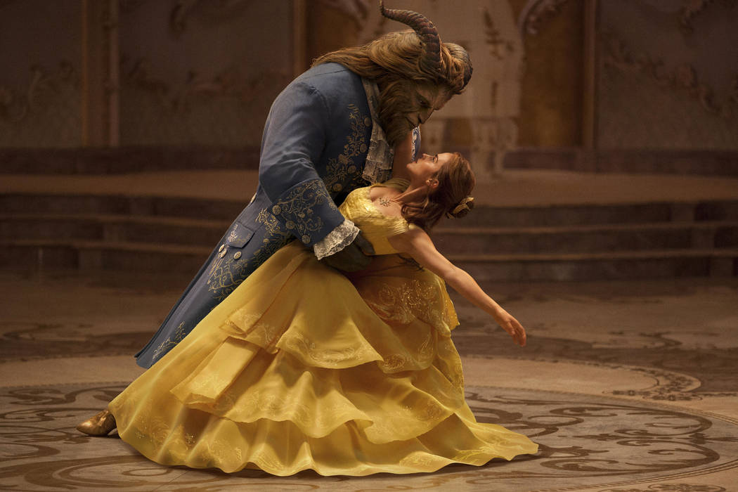 """This image released by Disney shows Dan Stevens as The Beast, left, and Emma Watson as Belle in a live-action adaptation of the animated classic """"Beauty and the Beast."""" (Disney v ..."""