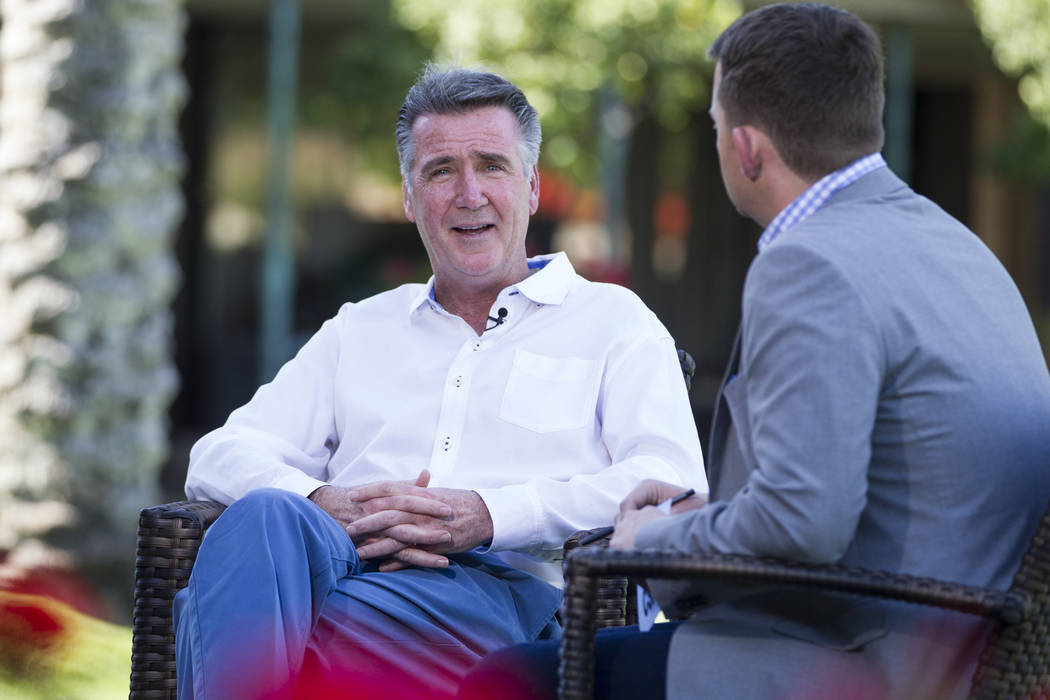 Washington Redskins Bruce Allen, left, is interviewed during the NFL Annual Meeting at the Arizona Biltmore Hotel on Sunday, March 26, 2017, in Phoenix, Ariz. (Erik Verduzco/Las Vegas Review-Journ ...